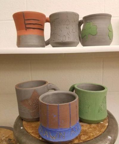 several pottery mugs