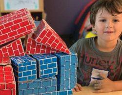 young boy with cardboard blocks