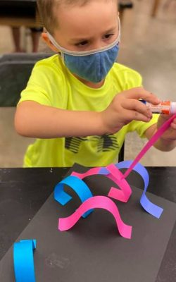 boy making paper art
